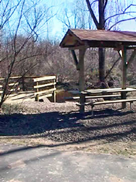 A picnic shelter by the Town and Country path