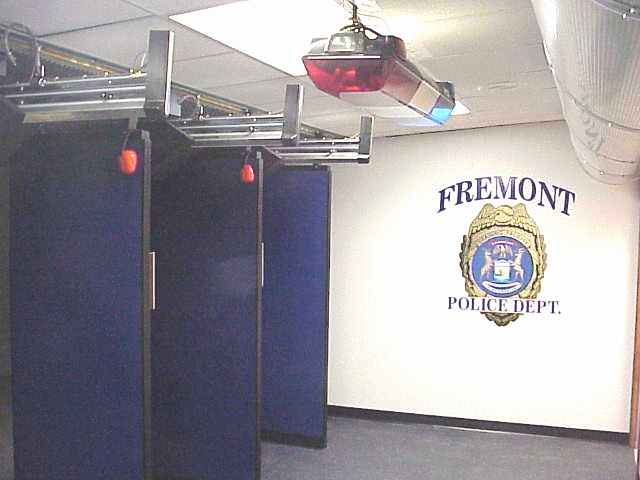 A view of the stalls in the shooting range with the Fremont Police Department badge on the wall
